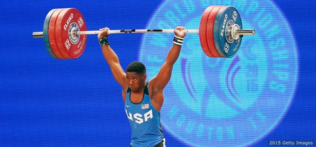HOUSTON, TX - NOVEMBER 22: Clarence Cummings Jr. of the United States competes in the men's 69kg weight class during the 2015 International Weightlifting Federation World Championships at the George R. Brown Convention Center on November 22, 2015 in Houston, Texas. (Photo by Scott Halleran/Getty Images)